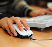 Photograph of hand manipulating a computer mouse